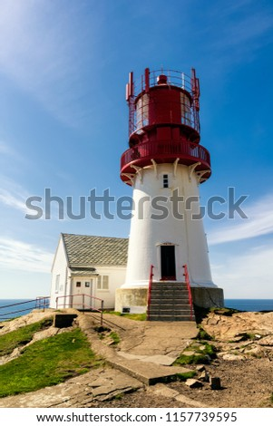 The World famous Lindesnes Fyr Lighthouse on most southern point of Norway staying on the edge of rocky sea coast, , South Norway, Lindesnes Fyr beacon. #1157739595
