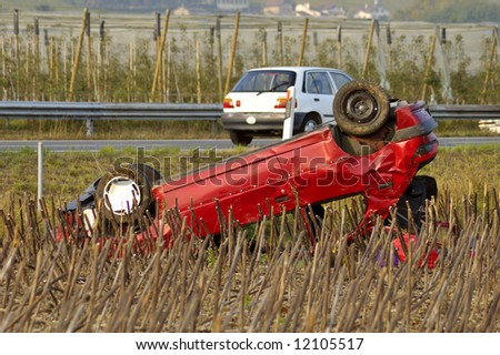 The wreck of a car, upside down beside a motorway (autoroute, freeway, autobahn)