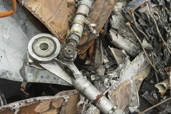 The wreckage of the plane, parts of the steering rods of the burned and broken aircraft at the dump of non-ferrous scrap metal for recycling.