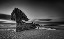 The wrecked ship, Baltray shipwrack, Shipwrecked off the coast of Ireland, An shipwreck or abandoned shipwreck,,boat Wreck Sunset light at the beach, Wrecked boat abandoned stand on beach or Shipwreck