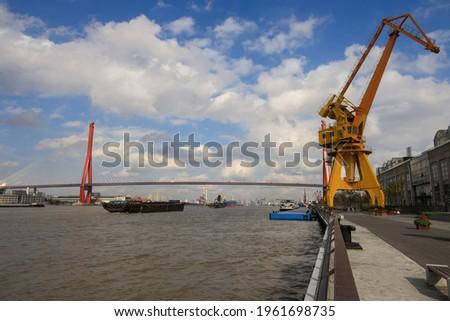 The Yangpu Bridge crossing the Huangpu River in Shanghai, China. Yangpu is among the world's longest bridges, with a total length of 8354 meters.  stock photo