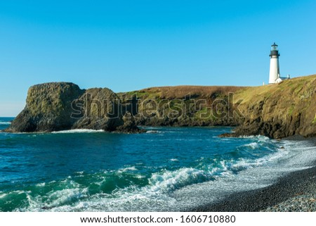 The Yaquina Head Lighthouse above the Rocky Ocean Shoreline in Newport, Oregon, USA