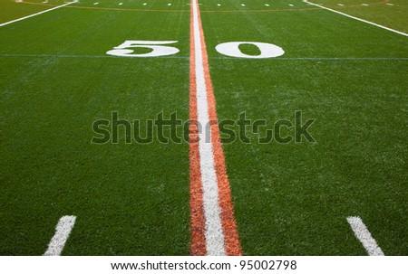 The 50 yard line of an American football field #95002798