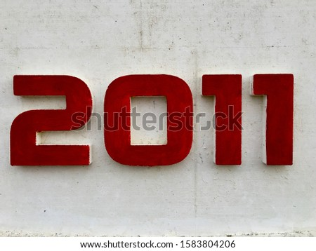 The year 2011, painted in red, indicating the date when the building was erected Foto stock ©