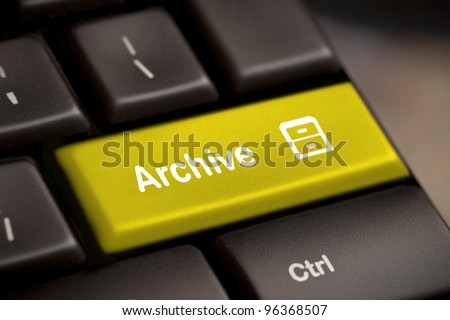 the yellow archive enter button key
