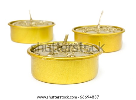 The yellow candles isolated on white background