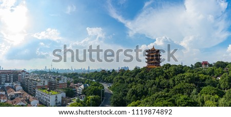 The yellow crane tower , located on snake hill in Wuhan, is one of the three famous towers south of yangtze river,China.4 Chinese letters on tower is