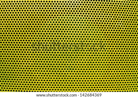the yellow grate background with holes