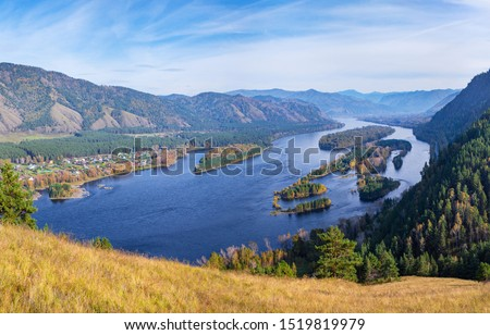 Photo of  The Yenisei River flows through a picturesque valley. Blue water and islands. South of Western Siberia.
