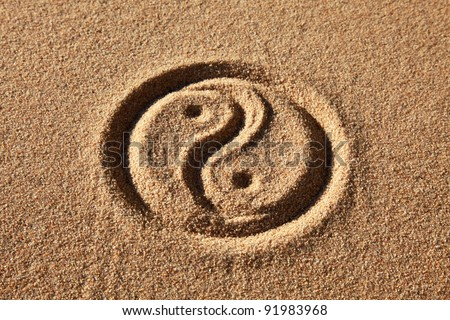 The Yin and Yang sign is written in sand