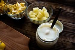 the yogurt cut fruits orange banana pineapple apple