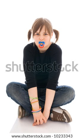 The young amusing girl with a dummy isolated on a white background