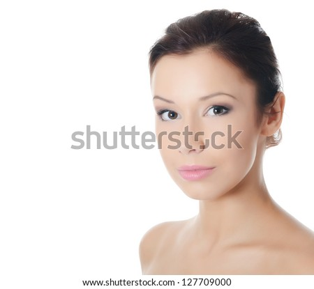 The young beautiful girl with natural make-up