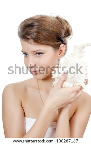 The young beautiful girl with seashell isolated