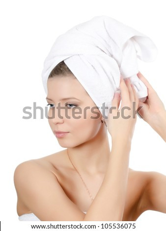 The young beautiful girl with towel on hair
