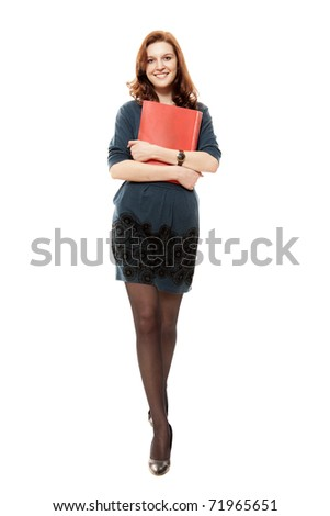 The young beautiful woman goes with a red folder - stock photo
