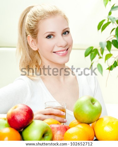 The young beautiful woman with the fresh fruits