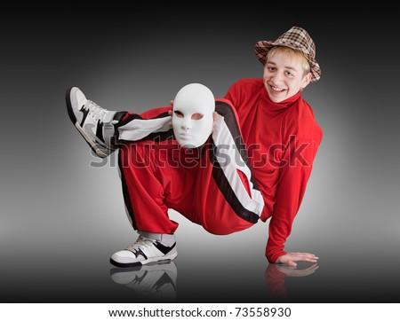 The young boy dances hip-hop
