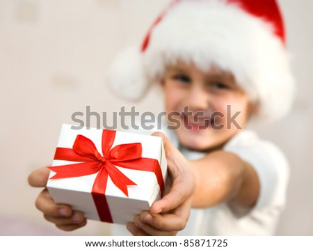 The young boy stretches out a beautiful gift in hands