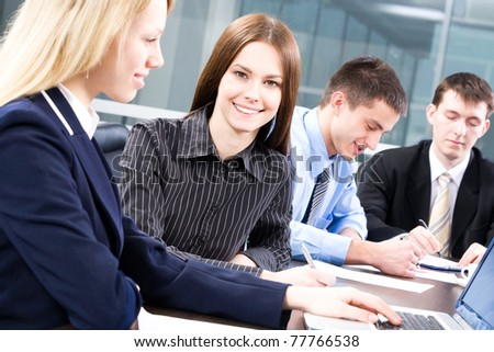 The young business woman working together with colleagues
