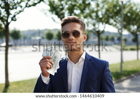 The young businessman shows off his profit Сток-фото ©