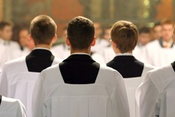 The young clerics of the seminary during Mass
