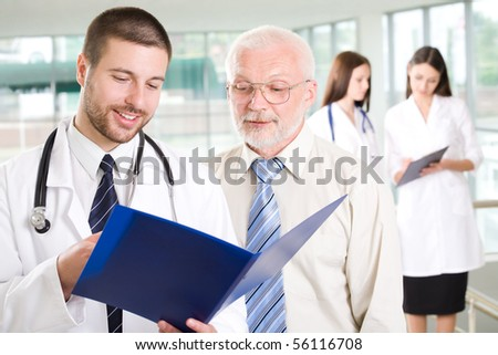 The young doctor talks to the patient