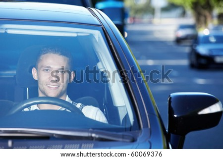 The young driver traveling on a busy highway