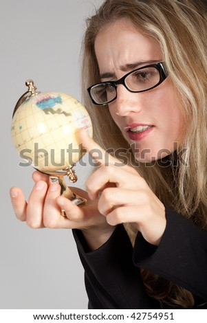 The young emotional girl in points and with the globe in hands - stock photo