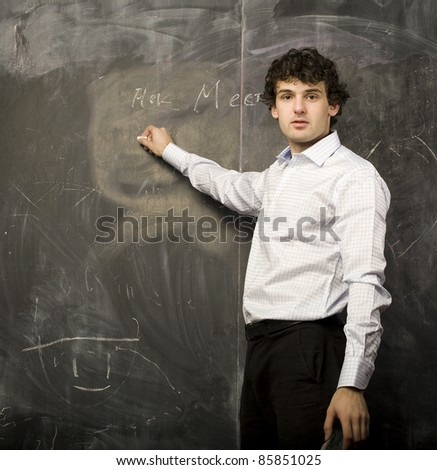 The young emotional student in class room, writing on blackboard