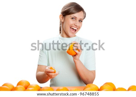 The young girl and oranges on a white background