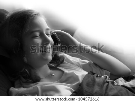 The young girl calling with her mobile phone. Child abuse concept.