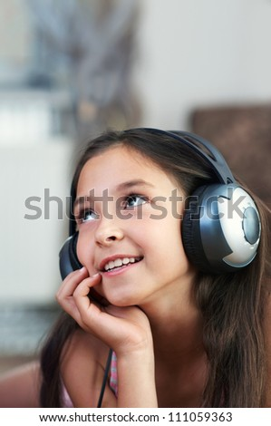 The young girl is listening to music