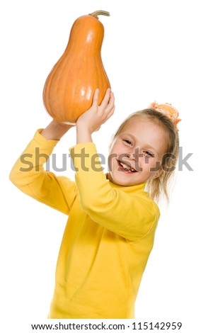 The young girl raised her pumpkin over his head on a white background.