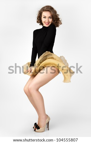 The young girl's skirt flies. Marilyn Monroe style. Fashion photo.