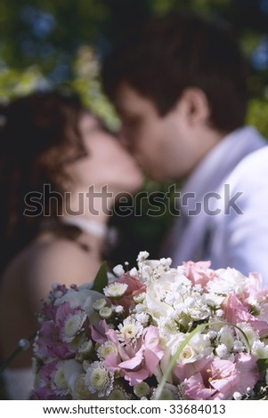 The young groom kisses the beautiful bride on day of  wedding
