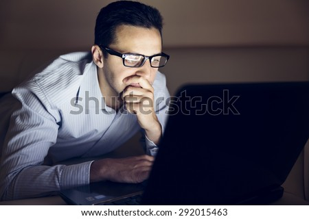 The young handsome man learn in his computer at night stock photo