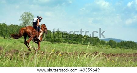 The young horseman on horseback. Traditional horse racing in Bashkortostan on holiday sabantuy #49359649