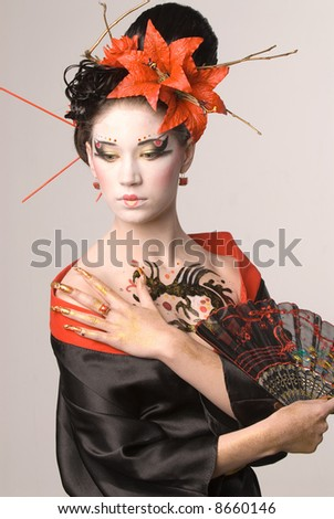 The young Japanese woman on a grey background