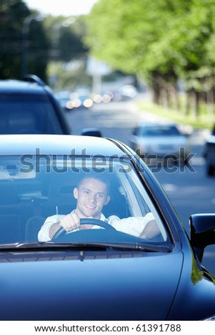 The young man driving a car