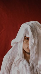 the young man in a white veil