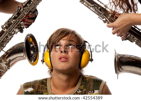 The young man in ear-phones and two saxophones. Loud noise.