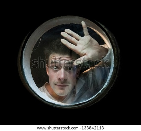 The young man looks the porthole