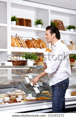 The young man points a finger at a product which wishes to buy