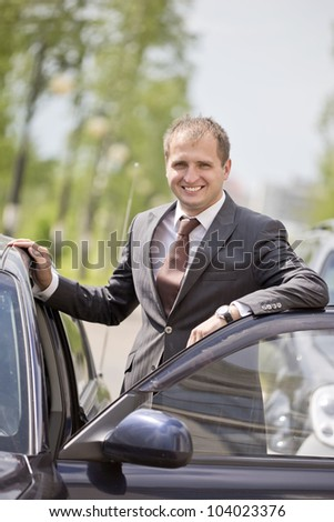 The young man sits down in the car