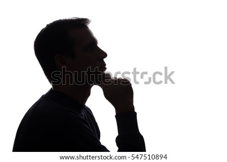 The young man thought his head propped on his hand - silhouette #547510894