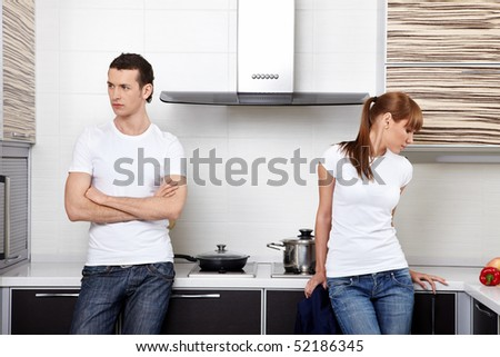 The young quarrelled couple on kitchen