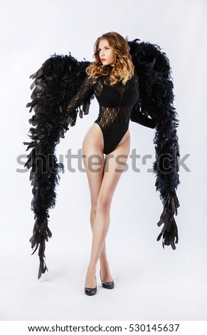 Stock Photo the young sexy woman in underwear with wings in an image of an angel (demon)