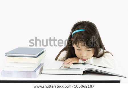 The young student reading the book on a white background