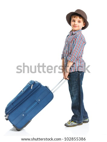 The young traveler boy with a suitcase. Isolated over white background